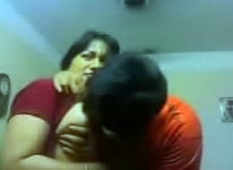 Crude Indian couple caress sensually lounge