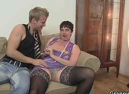Old bitch enjoys riding youthful dick